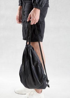 Black Patchwork Drawstring Backpack On Model